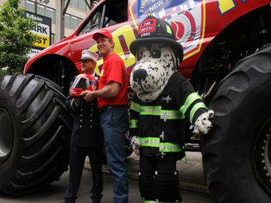 FDNY Captain Helf and Hot Dog the FDNY Mascot Pose with Tom Meents