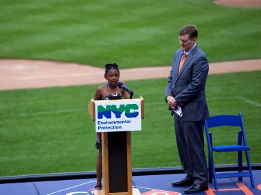 Chyanne Williams, a Water Ambassadors, from P.S. 153 of the Bronx reads her poem as Commissioner Cart Strickland stands by.