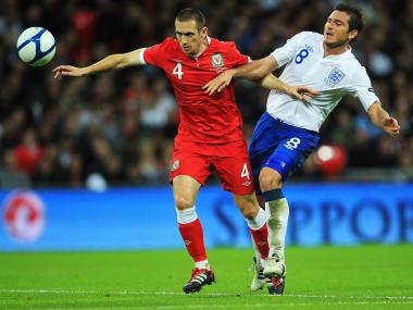 Andrew Crofts (L) of Wales and Frank Lampard of England challenge for the ball during the UEFA EURO 2012 group G qualifying match between England and Wales at Wembley Stadium on September 6, 2011 in London, England.