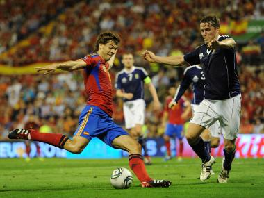 Fernando Llorente (L) of Spain tries to score past Christophe Berra of Scotland during the UEFA EURO 2012 Group I Qualifier between Spain and Scotland at the Rico Perez stadium on October 11, 2011 in Alicante, Spain.