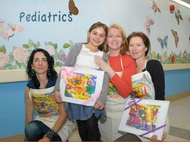 Pamela Talese, Emilia Victoria, Robinson Holloway and Jill Alexander hold their awards in front of their butterfly mural at St. Luke's Hospital.