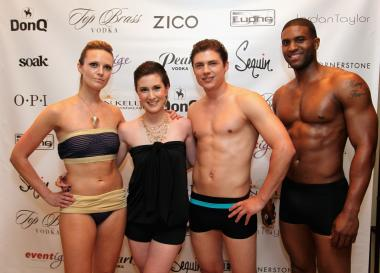 The models posing with designer Caitlin Kelly.