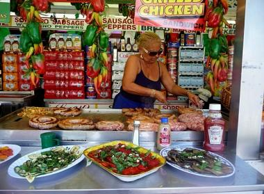 Lucy Spada, who has been turning out Italian street food at fairs across the city for 45 years, cooks sausage and peppers at the Feast of St. Anthony in Belmont, the Bronx, on June 7, 2012.