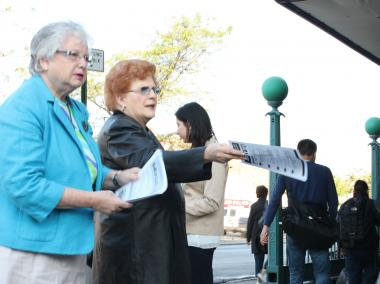 State Senator Toby Ann Stavinsky and city Council member Karen Koslowitz hand out flyers to  commuters early Friday morning in Rego Park.