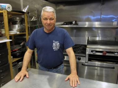 Retired firefighter Tony Catapano stands in the kitchen of the Friends of Firefighters headquarters, a restored firehouse at 199 Van Brunt St. in Red Hook.