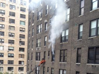 A shot from a neighboring building of the June 8, 2012 fire at 88 Central Park West.