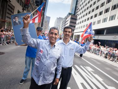 New York Sen. Adriano Espaillat joins Councilman Ydanis Rodriguez at the Puerto Rican Day parade on June 10, 2012.