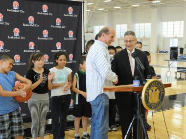 Assembly Speaker Sheldon Silver (right) was at the opening of Basketball City with owner Bruce Radler.