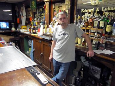 Kenneth Dunn, commander of VFW Post 709 in Sunset Park, stands at post's bar. The post has sued CBS, alleging that an adjoining building owned by the corporation has caused water and termite damage at the post.