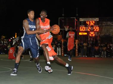Cabbie of Team 8732 drives toward the hoop during second half action.