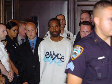 Robert Ellis (C) is escorted for his arraignment in the accused shooting of NYPD officers Herman Yan and Russel Timoshenko at Brooklyn Criminal Court July 13, 2007 in the Brooklyn borough of New York City. A judge denied bail for both defendants Ellis and Dexter Bostic.