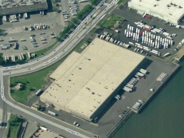 A building in the Hunts Point Food Distribution Center, which includes more than 115 private wholesalers operating from the Hunts Point Terminal Produce Market, the Cooperative Meat Market, and the New Fulton Fish Market.