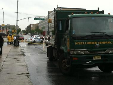 Police were checking the tires of this truck after a female bicyclist was struck and killed by a truck at Bedford Avenue and Empire Boulevard Tuesday morning.