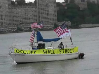 A small gang of 'Occu-pirates' or members of Occupy Wall Street, take their protest aboard a local's sailboat on June 13, 2012.
