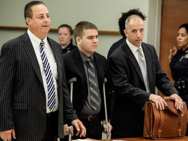 Officer Richard Haste, center, is arraigned on manslaughter charges in the fatal shooting of Ramarley Graham.