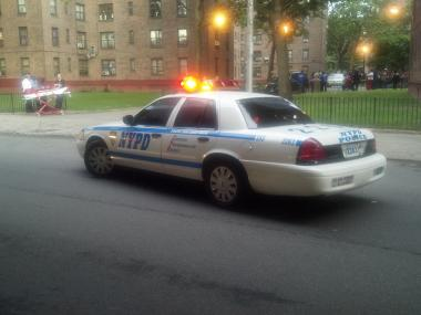 A police cruiser outside the Walt Whitman Houses, in Fort Greene, after a shootout on June 13, 2012.