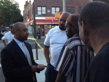 A detective talks to possible witnesses on June 14, 2012, in East Flatbush, after a cop-involved shooting that left a woman dead.