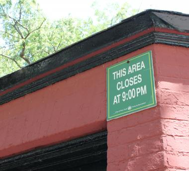 The DeKalb Avenue side of the park, where historic brownstones and long-limbed trees line the streets, remains open until 1 a.m. But on the Myrtle Avenue side, where Whitman and Ingersoll housing projects border the park, signs are posted that read,