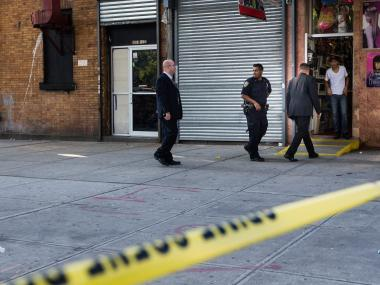 Police clear up a crime scene at West 155th Street in Manhattan on June 16, 2012.