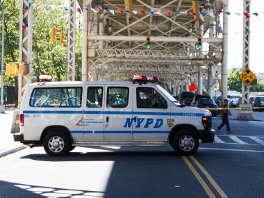 Police van in Sugar Hill at West 155th St. after a man was found dead, June 16, 2012.
