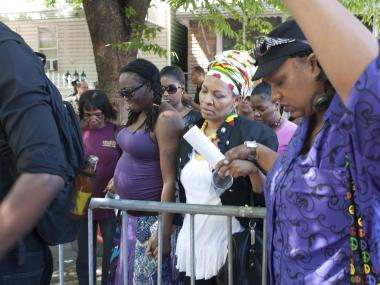 The protest outside of the 67 Precinct ended with a prayer. June 16, 2012.