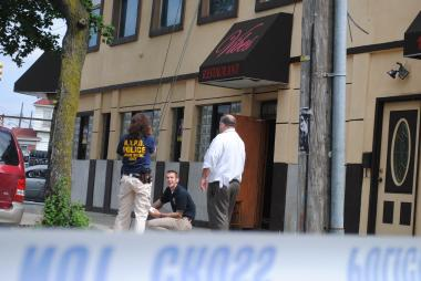 Police investigate the nightclub Vibes, at 143-06 Liberty Avenue, where a man was shot June 17, 2012.