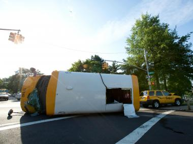 Five children and two adults were injured when a school bus overturned at a Briarwood intersection Monday, June 18, 2012, the FDNY said.