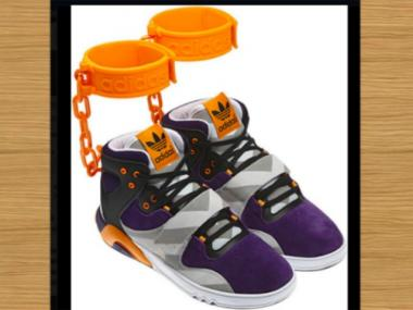 Adidas ran into controversy after unveiling an image on Facebook of these new purple-and-orange sneakers featuring plastic orange chains with a cuff strapping around the ankle.