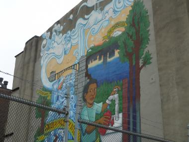 A mural about the water system looks over a work site on Fourth Avenue and Sackett Street where the Department of Environmental Protection is building a 700-foot underground shaft connected to the massive Third Water Tunnel project.