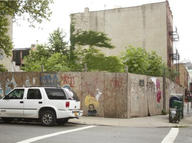 The empty lot at the corner of Douglass and Smith streets will become a bank, its owner said.