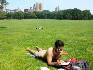 Marcos Duran, 28, relaxes in Lefferts Garden, in Central Park. Despite the park's proximity to the Upper East Side, residents say they don't have enough open space.