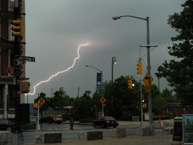 A bolt of lightning pierces the sky over New York Harbor on Monday June 25th, 2012.