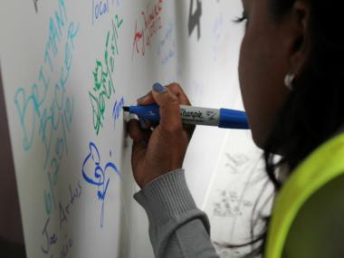 Farrah Man, who worked in project administration during the building of 4 World Trade Center, signed the skyscraper's final steel beam June 25, 2012.