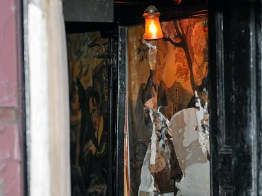 A piece of Edward Sorel's mural of Village legends in the Waverly Inn was damaged in Monday night's fire.