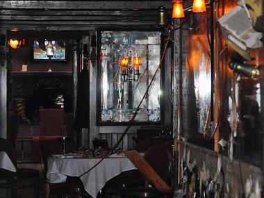 Firefighters damaged part of the Waverly Inn's famous mural when fighting a fire in the basement of 16 Bank St. on Monday, June 25, 2012.