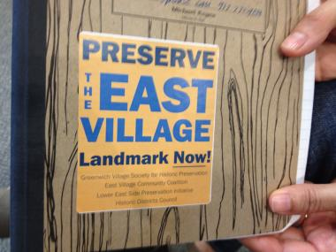 The Greenwich Village Society of Historic Preservation handed out stickers at Tuesday's hearing to supporters of the proposed East Village/Lower East Side Historic District.
