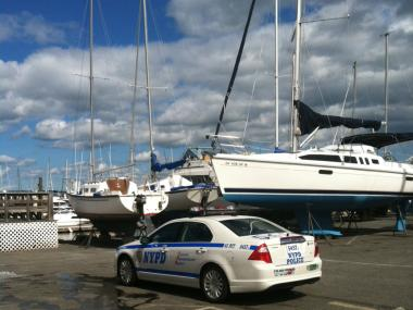 Police investigated a man's body floating off the coast of City Island.