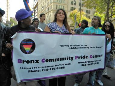 Marchers hold a Bronx Community Pride Center. The center is set to close in the coming days.