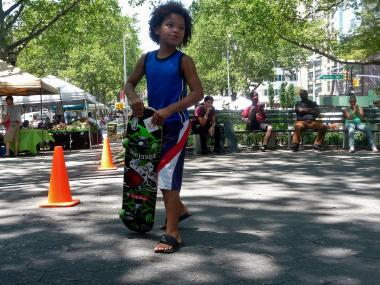 Oscar Vasquez, 6, took part in a free skateboarding lesson at the Mount Eden Farmers Market on June 28, 2012. Nonprofit group Harvest Home hosted the lesson as a way to draw more young people to sources of fresh food.
