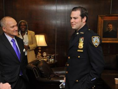 Sergeant Kevin Brennan with Police Commissioner Raymond Kelly after being promoted at One Police Plaza on June 29, 2012.