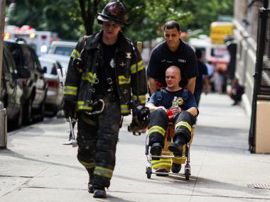 An FDNY firefighters leave the scene at 910 Riverside Drive in Washington Heights on July 1st, 2012.