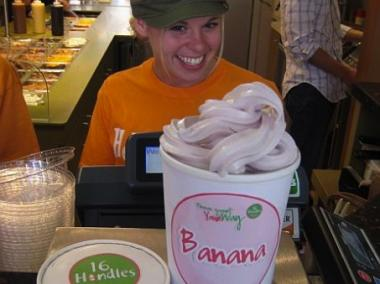 A 16 Handles employee weighs a giant frozen yogurt at the store. The make-your-own frozen yogurt chain is opening a new location in Williamsburg later this month.