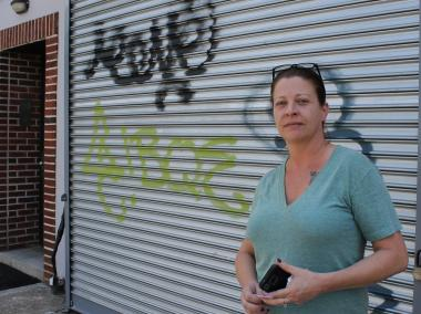 Meredith Chesney, whose salon is across from McCarren Pool on Bayard Street, said her rolldown gate was tagged this weekend after the pool's opening. Chesney and other neighbors said the crowds combined with a lack of trash cans and port-a-potties has caused more litter.