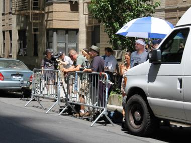 Press wait outside of Katie Holmes' Chelsea apartment hoping for a glimpse of the actress.