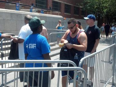 Parks Department staff check bags at the entrance to McCarren Pool on July 4, 2012.