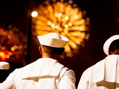 A U.S. Navy sailor enjoys the annual Independence Day firework show on the Hudson River.