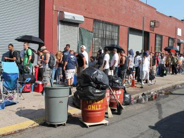 More than 1,000 people waited in line despite scorching heat Thursday morning for the chance to become a plumber's apprentice.