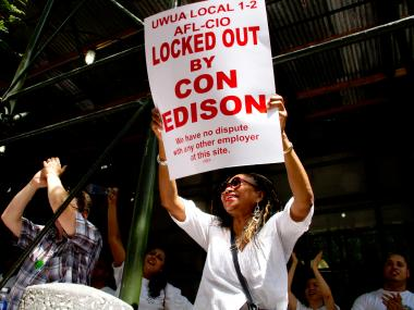 A Con Ed worker protests Thursday in front of the company's Manhattan headquarters at 4 Irving Place near Union Square to protest a company lockout after failed contract negotiations Sunday.