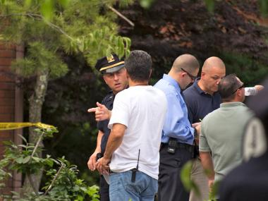 A cop at the Forest Hill Road home where a woman was found dead on July 5, 2012.