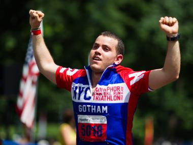 An athlete crosses the finish line at this years New York City Triathlon on July 8th, 2012.